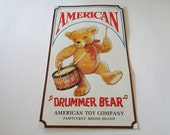 Vintage American Toy Company Drummer Bear  Embossed Tin Sign