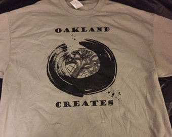 Oakland Creates art show Tee Shirt