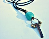 Black Faux Suede Cord No Clasp Necklace with Stone Shell and Brass Pendant: Pendulum