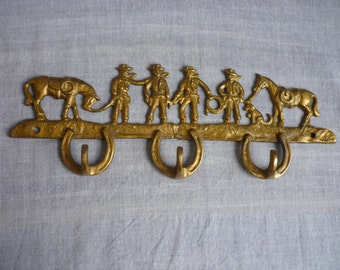 Vintage brass cowboy wall hooks,  rack of three brass hooks,  brass horseshoe hooks
