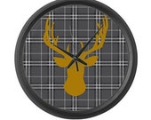 Deer head wall clock in orange on gray black and white plaid background