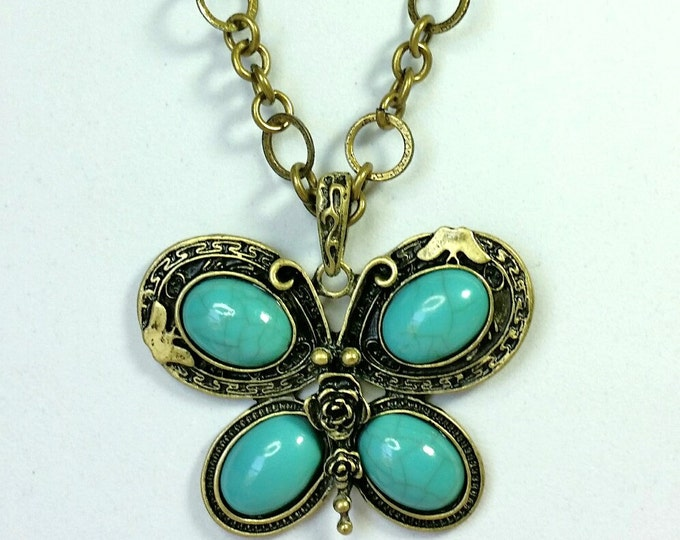 Turquoise Butterfly Pendant with Antique Brass Mount and Chain
