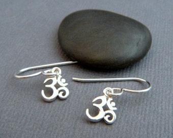tiny sterling silver Om earrings. small Ohm earrings. dainty dangle. petite drop earrings. simple zen yogi yoga jewelry. gift for her