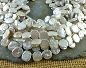 Keshi Coin Pearls - 10 to 12mm Top Drill - White With Silver Undertone and Rainbow Luster - Full Strand