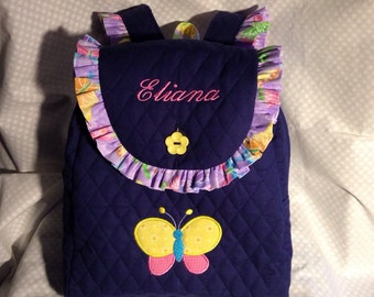 Child's Backpack in Navy with purple butterfly accents and butterfly applique.