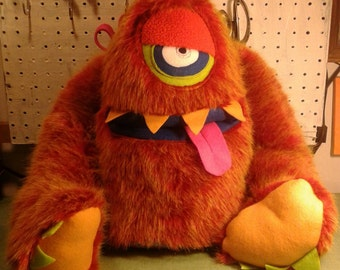 Large Red/orange monster with screenprinted bottom and pocket mouth.