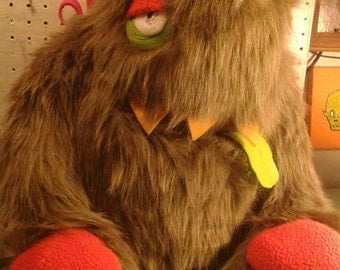 Brown/grey ex large 2 eyed monster with pocket mouth!