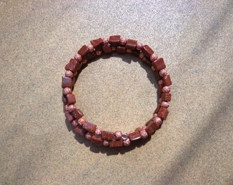 Goldstone Bracelet, Brown Glass Rectangles and Textured Copper Beads on Self-Coiling Wire, Copper Sparkles, Copper Healing Properties