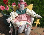 Angel Cat Soft Sculpture Cloth Doll designed by Daisy Kingdom is handmade from heart of Ohio