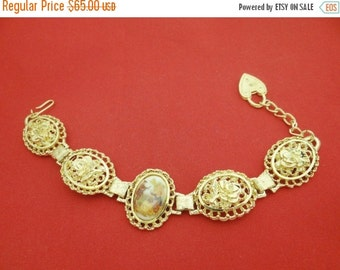 "20% off sale Vintage 7"" gold tone bracelet with LIMOGES charm signed Fragonard in great condition, appears unworn"