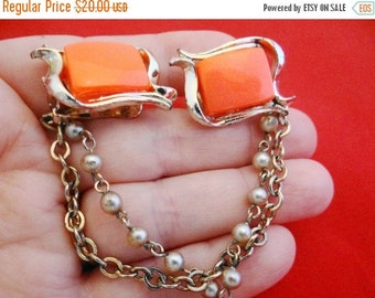 """20% off sale Vintage 7"""" gold tone sweater guard with neon orange thermoset insets in great condition"""