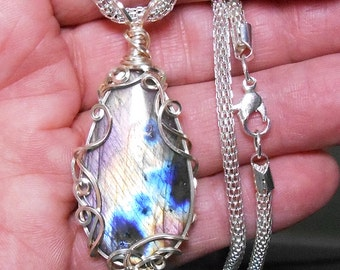 labradorite  pendant,  bright well centered flash, magenta, yellow and blue fire, hand wrapped, silver filigree setting