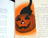 Black Cat in Pumpkin Laminated Bookmark - Sammy Eyes a Pumpkin Illustration