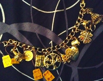 Vintage Monet Charm BRACELET. Gold tone charmes.  New Old Stock with TAGS. 1950's.  10 Fabulous Charms