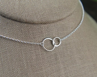 Tiny linked circles necklace in sterling silver, entwined links, interlocking circles, connected rings, two circles