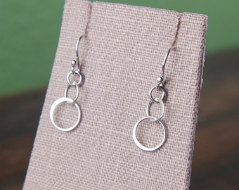 Tiny three linked circles earrings in sterling silver, entwined circles, circle drop earrings, interlocking rings, hoop earrings