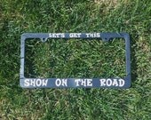 Let's Get This Show On The Road License Plate Frame