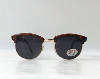 vintage 1980's NOS clubmaster sunglasses tortoise shell plastic gold metal frames black lenses sun glasses accessories retro modern fashion