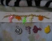vintage   cracker jack prize  charms bracelet   with 9  charms