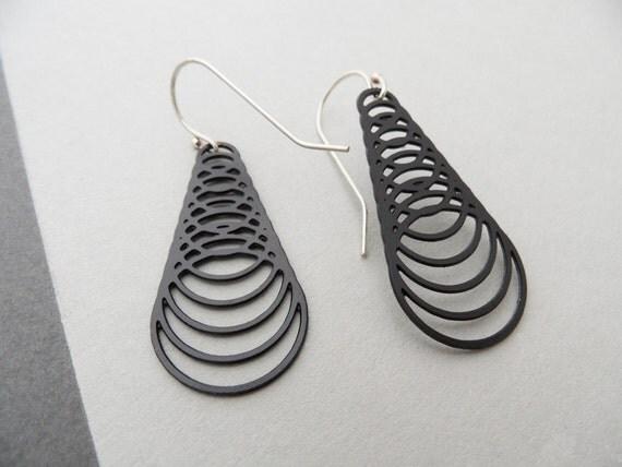 black cyclone earrings