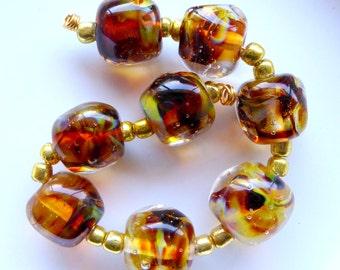 Destash Lampwork beads handformed nuggets rich brown amber by Judith Billig