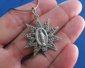 Vintage 40s very rare sterling religious medal surrounded by star of marcasite absolutely beautiful piece