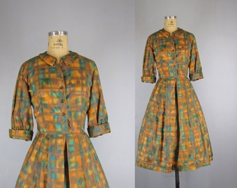 vintage 1950s vivid day dress / orange, turquoise, gold and brown abstract patterned shirtwaist dress with full skirt / medium