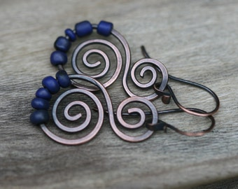 Rustic Solid Copper Swirled Dangle and  and Indonesian Glass beads - simplistic  artisan handmade everyday wear , red metal , royal blue