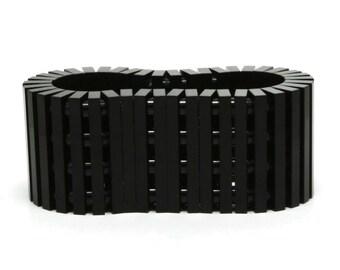 Black bracelet made with LEGO® bricks