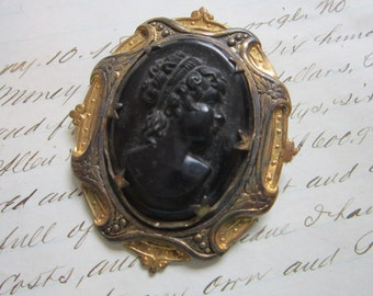 vintage black cameo brooch - gold tone frame - 2 x 2.25 inches - as is