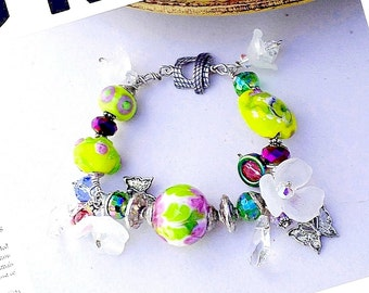 Lemon yellow pink and purple lampwork wire wrapped lampwork SS bracelet