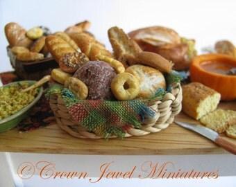 1:12 Artisan Bread Assortment in Woven Basket by IGMA Artisan Robin Brady-Boxwell - Crown Jewel Miniatures