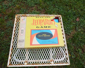 Jeopardy Game Sixth Edition by Milton Bradley 1964  players are given the answers and asked to come up with the question for 3-5 player
