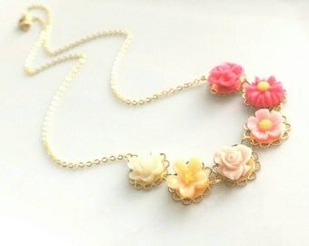 Ombre Necklace - flower cameo style resin floral charms on scalloped gold setting - hot pink fuchsia to cream white - lacy pretty feminine