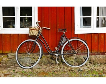 Fine Art Color Photography of a Bicycle Against a Red Home in Sweden