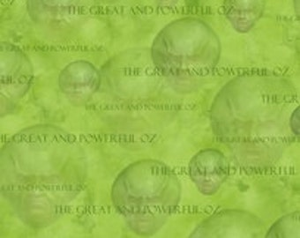 Wizard of Oz - 75 Years of WIckedness Green The Great and Powerful Oz Tossed Heads fabric - 1 yard