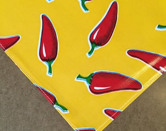 48x48 Oilcloth Tablecloth Chili Peppers on Yellow with a Simple Hem