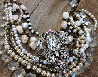 Handcrafted Jo'ellie white turquoise and vintage chandelier crystal statement layered necklace.