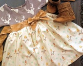 Timber dress with attached sash and bow. Features a Deer head top in soft knit and southeast print on cotton skirt. Fall Autumn girls dress