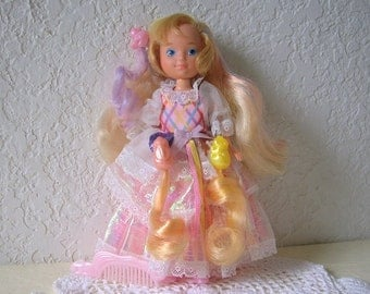 Lady Lovely Locks doll wearing her original dress with three pixie tails, shoes and comb.  Vintage 1980s toy