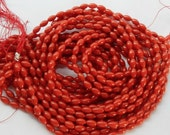 Red bamboo coral rice bade (4x7mm) full strand (16 inches)