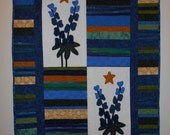 Folksy quilted wall hanging with bluebonnets