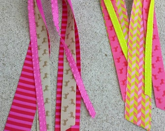 Pink or brown horsing around  streamer ribbons