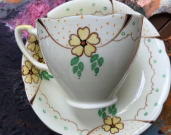 Green and yellow  teacup set with stylized buttercups
