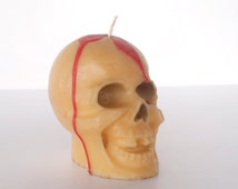 Vintage Gurley candle, bleeding skull Halloween decoration, yellow wax bloody skeleton head holiday decor, spooky, creepy, scary, gothic