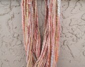 Handspun art yarn PALE BLOOM 44 yards free U.S. shipping salmon rust yellow