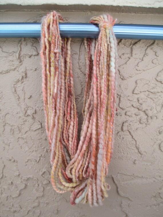 Handspun art yarn PALE BLOOM 44 yards free U.S. shipping salmon rust yellow