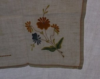 Vintage Tablecloth or Topper in Off White Linen, Orange Cross Stitch Border with Orange, Gold, Blue and Green Embroidery