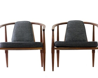 Pair of upholstered barrel back mid-century modern chairs