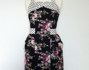 Retro apron with bow, flowers on a black fabric, black polka dots on a cream background.